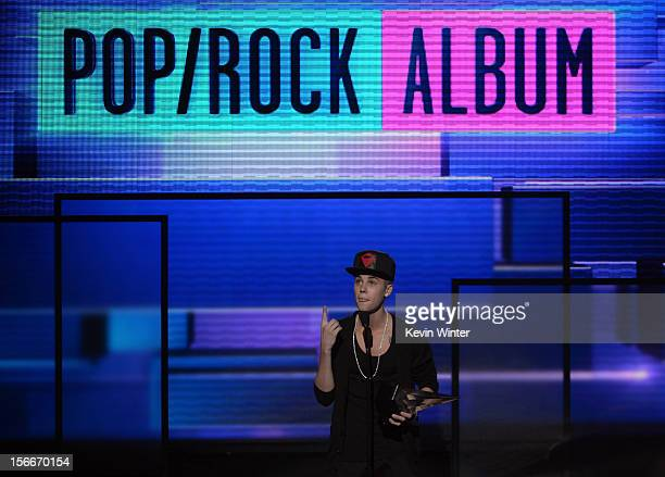 Singer Justin Bieber accepts the award for Favorite Pop/Rock Album onstage during the 40th American Music Awards held at Nokia Theatre LA Live on...