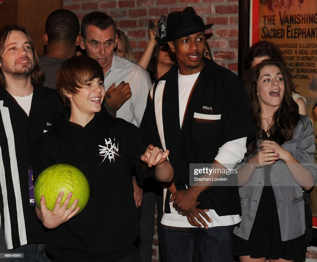 Singer Justin Bieber and actor/TV personality Nick Cannon attend 92.3 NOW's 'Bowling with Bieber' record release party at Lucky Strike Lanes & Lounge on March 23, 2010 in New York City.