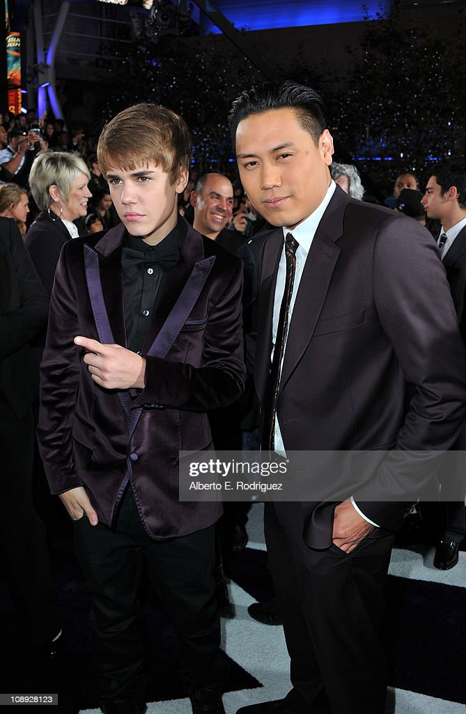 Singer Justin Bieber and Director Jon M. Chu arrive at the premiere of Paramount Pictures' 'Justin Bieber: Never Say Never' held at Nokia Theater L.A. Live on February 8, 2011 in Los Angeles, California.