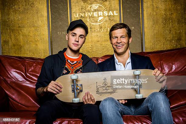 Singer Justin Bieber and Frank Briegmann pose for a photo during Universal Inside 2015 organized by Universal Music Group at MercedesBenz Arena on...