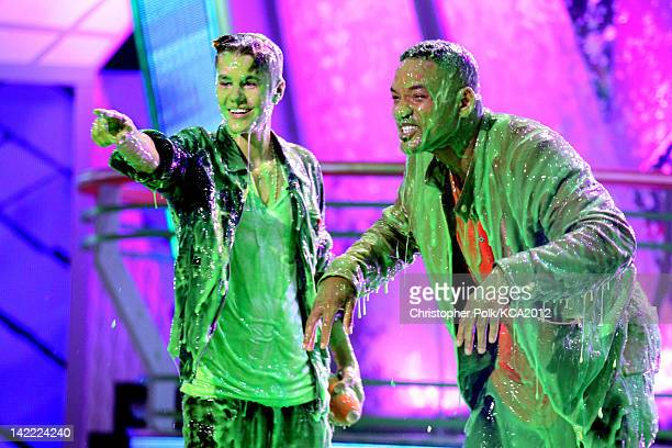 Singer Justin Bieber and host Will Smith get slimed at Nickelodeon's 25th Annual Kids' Choice Awards held at Galen Center on March 31 2012 in Los...