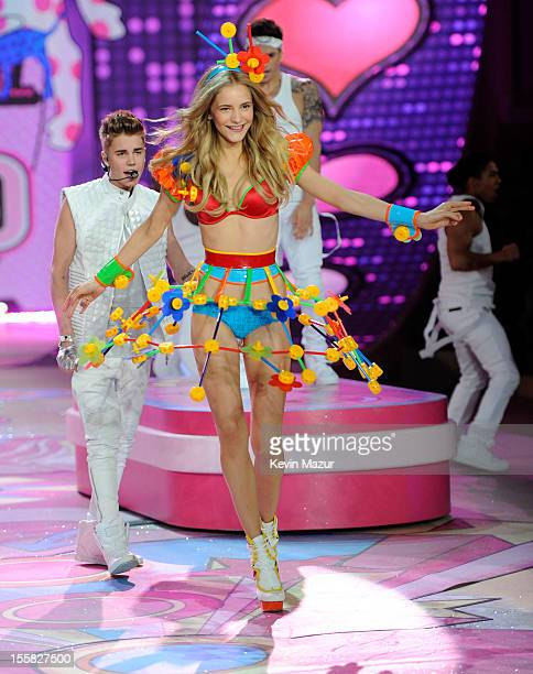 Singer Justin Bieber and model Dorothea Barth Jorgensen on stage during the 2012 Victoria's Secret Fashion Show at the Lexington Avenue Armory on...