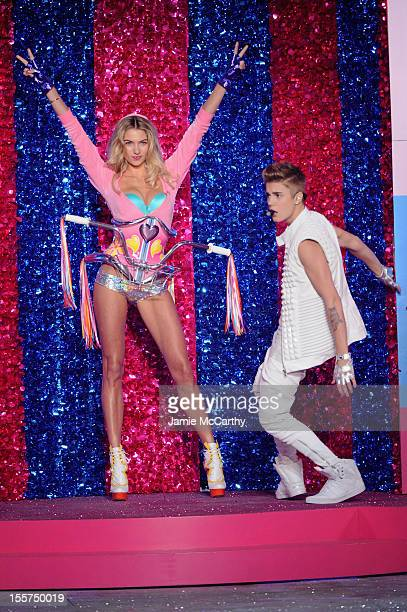 Singer Justin Bieber and model Jessica Hart onstage during the 2012 Victoria's Secret Fashion Show at the Lexington Avenue Armory on November 7 2012...