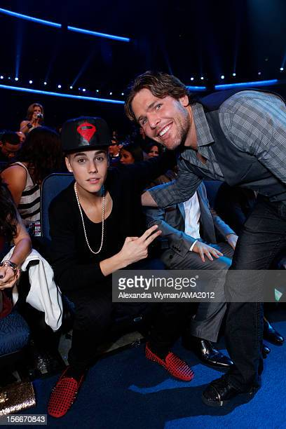Singer Justin Bieber and NHL Player Mike Fisher at the 40th American Music Awards held at Nokia Theatre LA Live on November 18 2012 in Los Angeles...