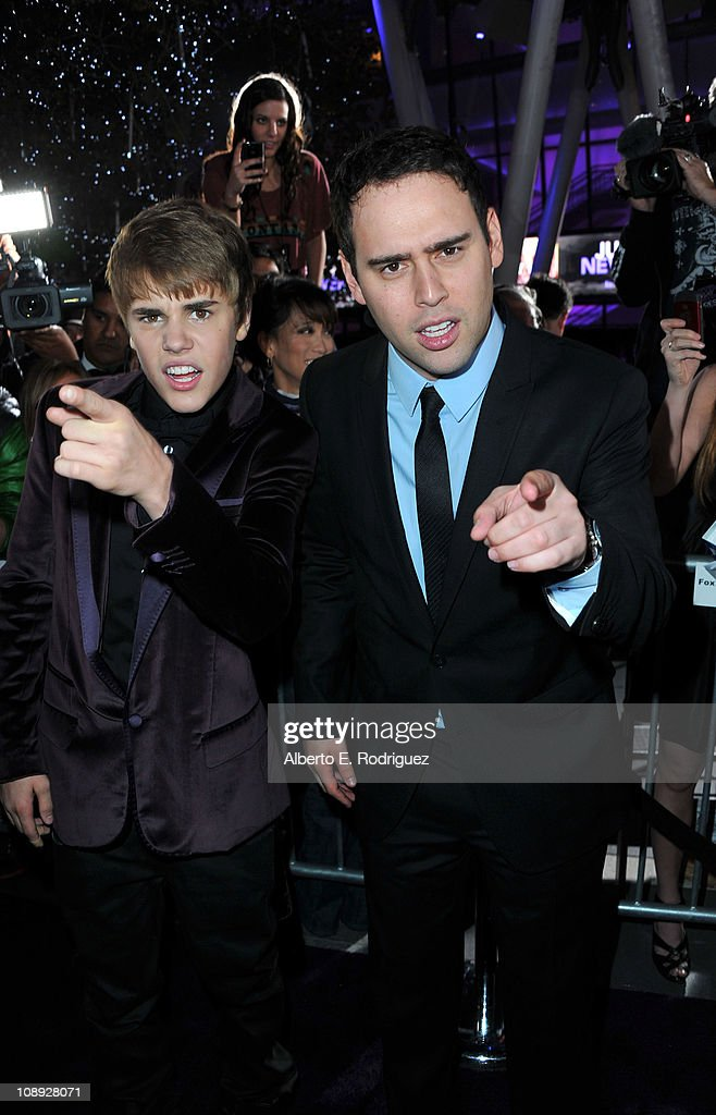 Singer Justin Bieber (L) and producer Scooter Braun arrive at the premiere of Paramount Pictures' 'Justin Bieber: Never Say Never' held at Nokia Theater L.A. Live on February 8, 2011 in Los Angeles, California.