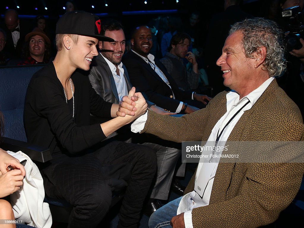 Singer Justin Bieber and producerof the American Music Awards Larry Klein at the 40th American Music Awards held at Nokia Theatre L.A. Live on November 18, 2012 in Los Angeles, California.