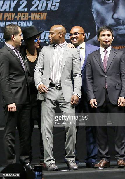 Singer Justin Bieber and professional boxers Floyd Mayweather and Manny Pacquiao attend the press conference to announce the upcoming fight with...