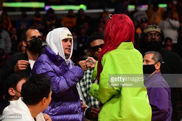 Singer, Justin Bieber and Rapper, Saweetie attend a game between the Golden State Warriors and the Los Angeles Lakers on October 19, 2021 at STAPLES...