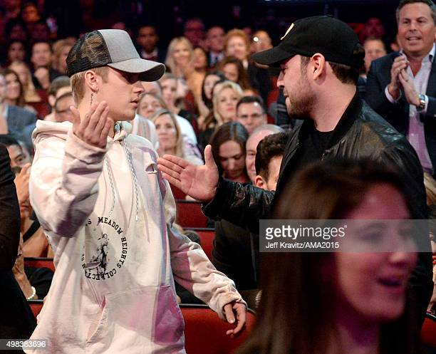Singer Justin Bieber and talent manager Scooter Braun attend the 2015 American Music Awards at Microsoft Theater on November 22 2015 in Los Angeles...