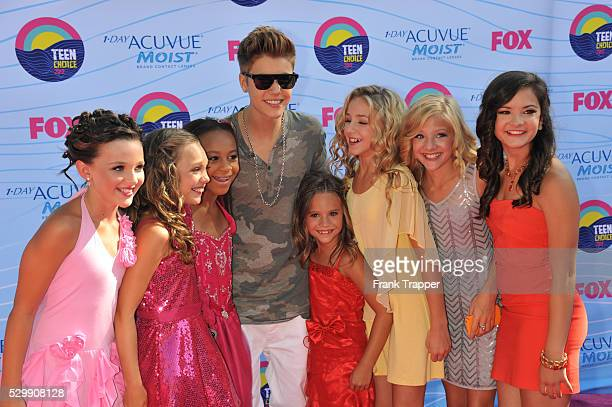 Singer Justin Bieber and the stars of Dance Moms arrive at the 2012 Teen Choice Awards held at the Gibson Amphitheatre in Universal City California
