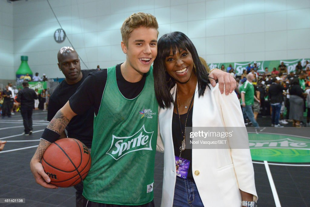 Singer Justin Bieber (L) and Vice President of Sprite Trademark at The Coca-Cola Company Kimberly Evans Paige attend the Sprite Celebrity Basketball Game during the 2014 BET Experience At L.A. LIVE on June 28, 2014 in Los Angeles, California.