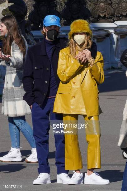 Singer Justin bieber and wife Hailey Baldwin Bieber are seen strolling on the Pont Alexandre III on February 28, 2021 in Paris, France.