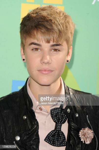 Singer Justin Bieber arrives at the 2011 Teen Choice Awards held at the Gibson Amphitheatre on August 7 2011 in Universal City California