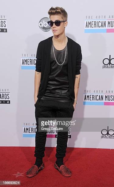 Singer Justin Bieber arrives at the 40th Anniversary American Music Awards at Nokia Theatre LA Live on November 18 2012 in Los Angeles California