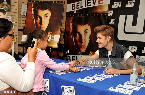 Singer Justin Bieber attends an autograph signing and fan meet and greet at JR Music and Computer World on June 19 2012 in New York City