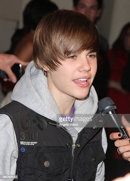 Singer Justin Bieber attends Perez Hilton's 'CarnEvil' 32nd birthday party at Paramount Studios on March 27 2010 in Los Angeles California