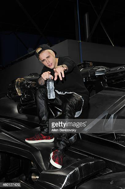 Singer Justin Bieber attends the Grand Opening of West Coast Customs Burbank Headquarters at West Coast Customs on December 7, 2014 in Burbank,...