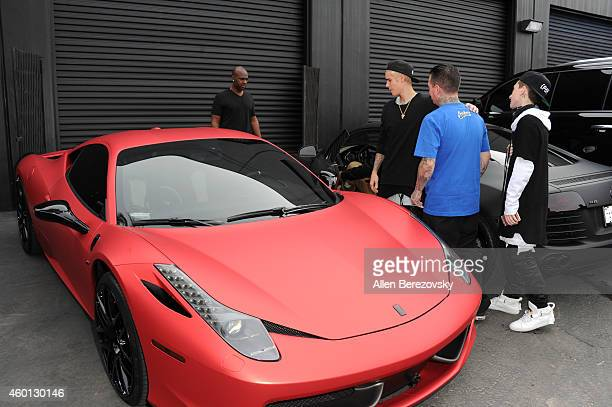 Singer Justin Bieber founder of West Coast Customs Ryan Friedlinghaus and his son Ryan Friedlinghaus Jr attend the Grand Opening of West Coast...
