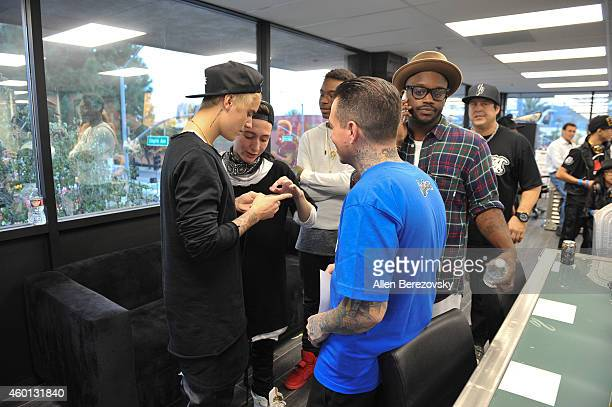 Singer Justin Bieber founder of West Coast Customs Ryan Friedlinghaus his son Ryan Friedlinghaus Jr and DJ Tay James attend the Grand Opening of West...