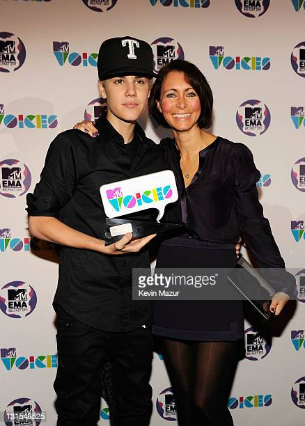 Singer Justin Bieber is awarded the MTV Voices Award with Senior Vice President of Social Responsibility and Head of MTV Staying Alive Georgia Arnold...