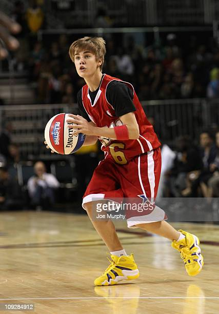 Singer Justin Bieber of the West drives the ball against the East during the BBVA 2011 NBA AllStar Celebrity Game on center court at Jam Session...