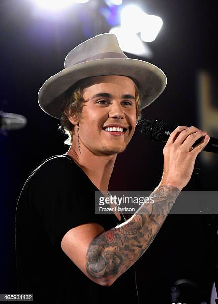Singer Justin Bieber performs at the 11th Annual Desert Smash Hosted By Will Ferrell Benefiting Cancer For College at La Quinta Resort and Club on...