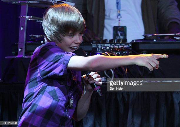 Singer Justin Bieber performs at the 3rd annual Tiki Rocks The Square for the Children's Miracle Network at the Hard Rock Cafe Times Square on...