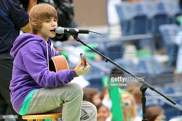 Singer Justin Bieber performs during Arthur Ashe Kid's Day at the 2009 US Open at the Billie Jean King National Tennis Center on August 29 2009 in...