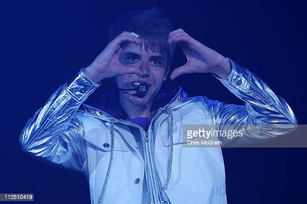 """Singer Justin Bieber performs on stage during his"""" My World"""" show on April 19, 2011 at the Singapore Indoor Stadium in Singapore."""