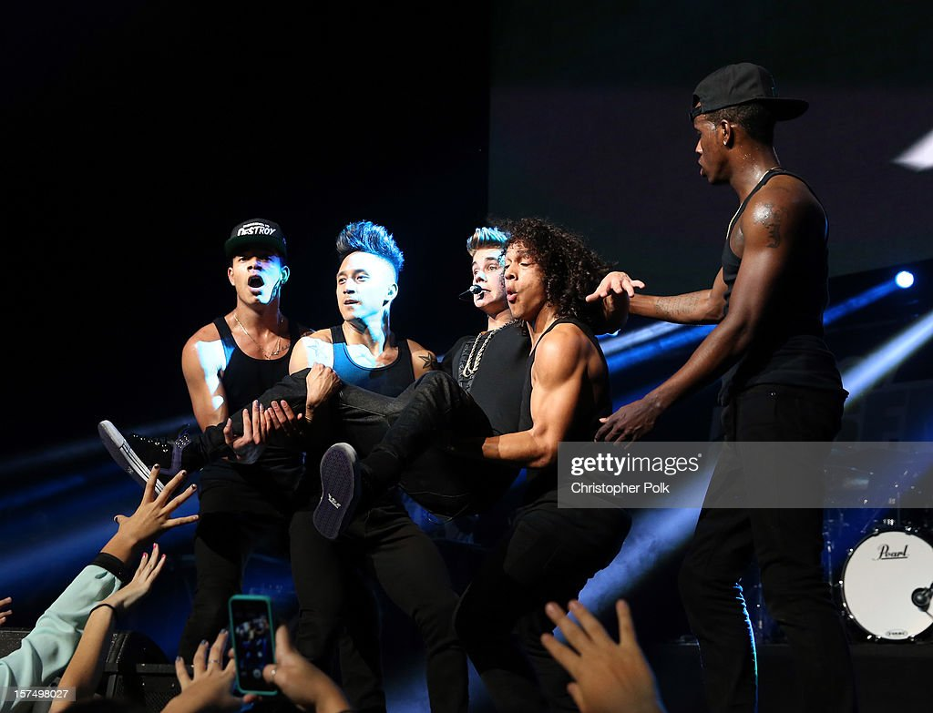 Singer Justin Bieber performs onstage during KIIS FM's 2012 Jingle Ball at Nokia Theatre L.A. Live on December 3, 2012 in Los Angeles, California.