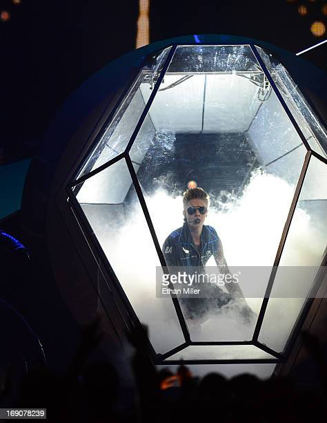 Singer Justin Bieber performs onstage during the 2013 Billboard Music Awards at the MGM Grand Garden Arena on May 19 2013 in Las Vegas Nevada
