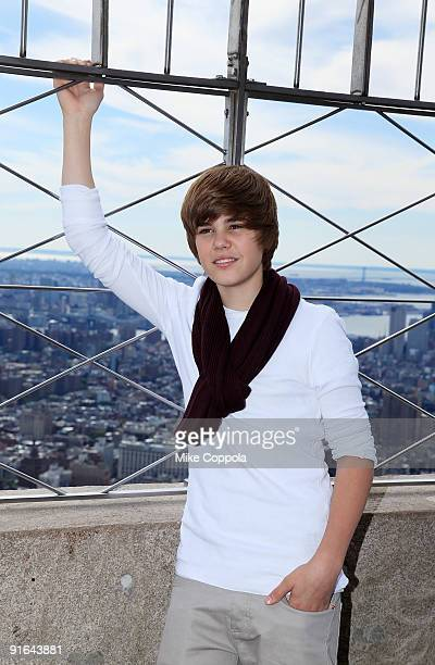 Singer Justin Bieber poses at the The Empire State Building in honor of Jumpstart's 4th Annual National Read for the Record Day on October 8 2009 in...