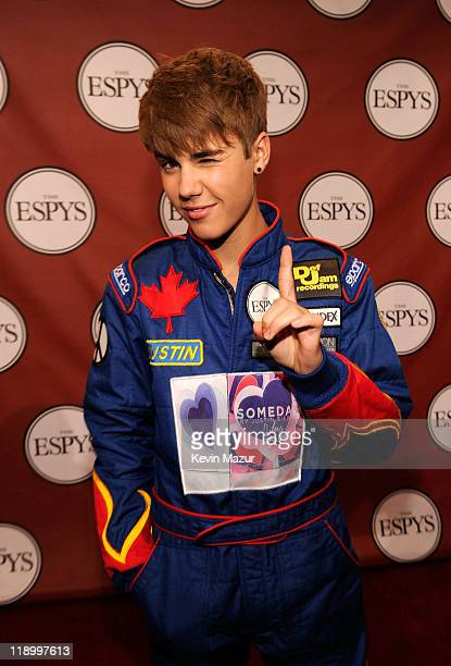 Singer Justin Bieber poses backstage after presenting the award for 'Best Team' at The 2011 ESPY Awards held at the Nokia Theatre LA Live on July 13...