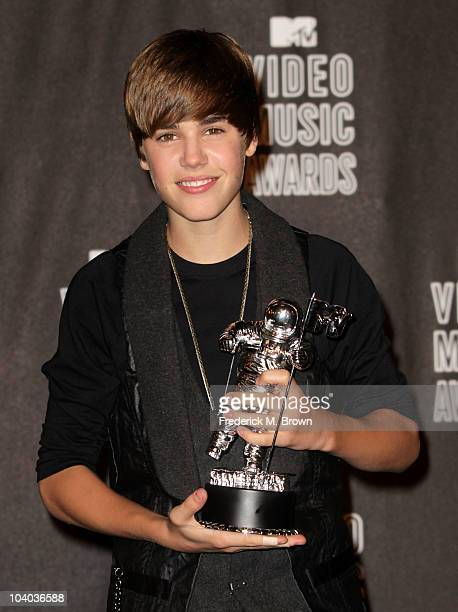 Singer Justin Bieber poses in the press room with his award for Best New Artist during the MTV Video Music Awards at NOKIA Theatre LA LIVE on...