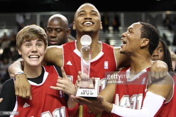 Singer Justin Bieber RB Artist Trey Songz and RB Artist Romeo Miller of the West celebrates Justin Bieber's MVP win against the East during the BBVA...