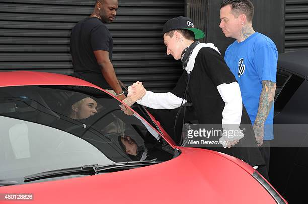 Singer Justin Bieber says goodbye to Ryan Friedlinghaus Jr and founder of West Coast Customs Ryan Friedlinghaus during the Grand Opening of West...