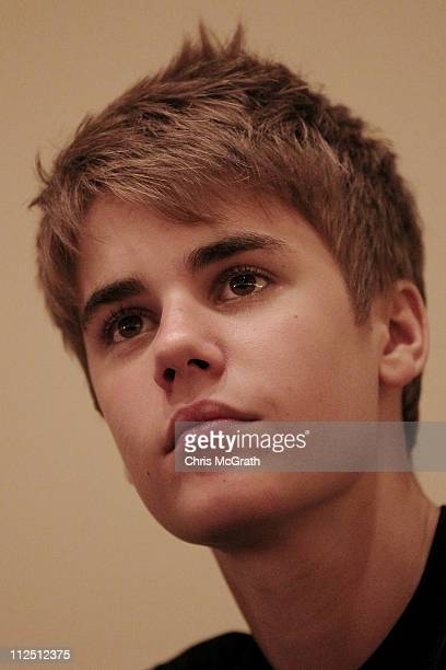 """Singer Justin Bieber talks to media at a press conference prior to the start of his """" My World"""" concert on April 19, 2011 at the Singapore Indoor..."""