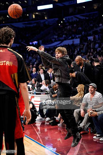 Singer Justin Bieber throws the ball during the 2011 NBA AllStar game at Staples Center on February 20 2011 in Los Angeles California NOTE TO USER...