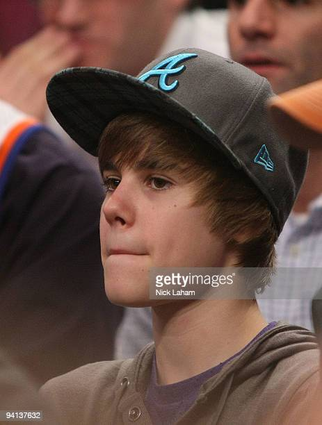 Singer Justin Bieber watches the game between the New York Knicks and the Portland Trail Blazers at Madison Square Garden on December 7 2009 in New...