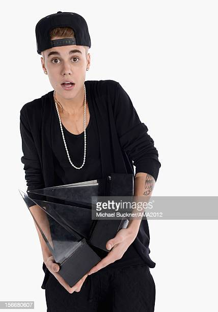 Singer Justin Bieber winner of 3 AMA Awards poses for a portrait at the 40th American Music Awards Getty Images Wonderwallcom Portrait Studio held at...