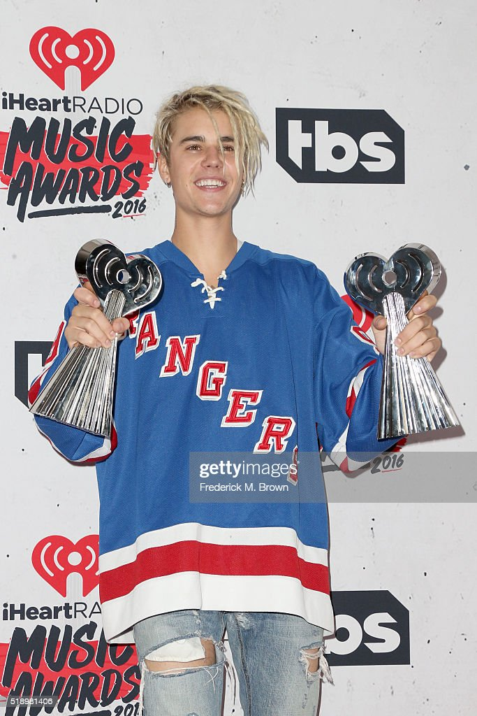 Singer Justin Bieber, winner of the awards for Best New Artist and Best Dance Song, poses in the press room during the iHeartRadio Music Awards at The Forum on April 3, 2016 in Inglewood, California.