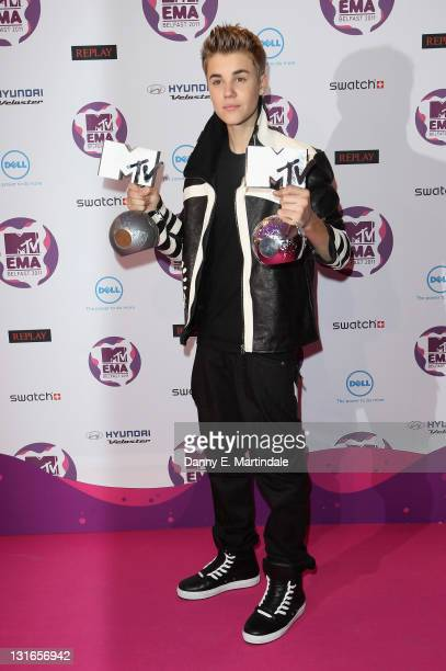 Singer Justin Bieber with awards attends the MTV Europe Music Awards 2011 at Odyssey Arena on November 6 2011 in Belfast Northern Ireland
