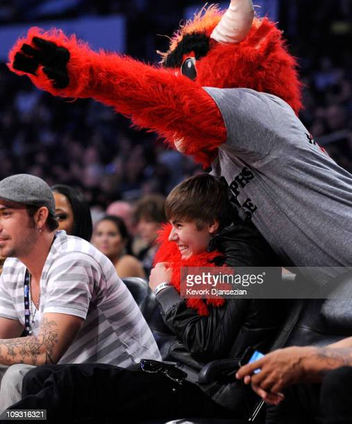 Singer Justin Bieber with Chicago Bulls mascot 'Benny the Bull' in the audience during the 2011 NBA AllStar game at Staples Center on February 20...