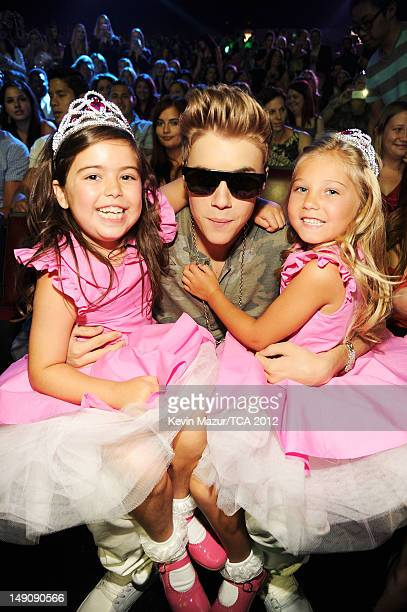 Singer Justin Bieber with Sophia Grace Brownlee and Rosie McClelland in the audience during the 2012 Teen Choice Awards at Gibson Amphitheatre on...