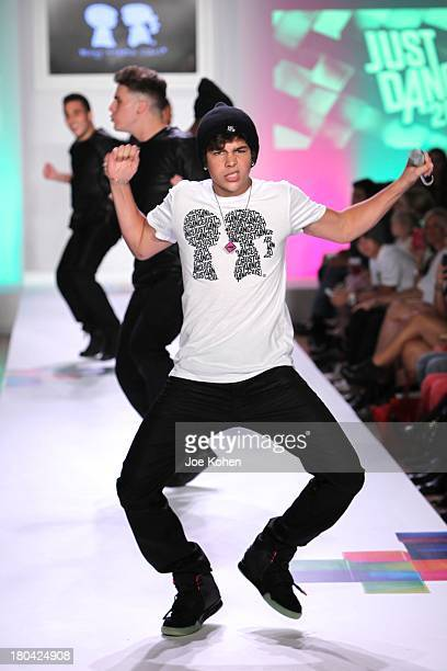 Singer Justin Mahone performs at the Just Dance with Boy Meets girl by Stacy Igel fashion show during Style360 Spring 2014 at Metropolitan Pavilion...