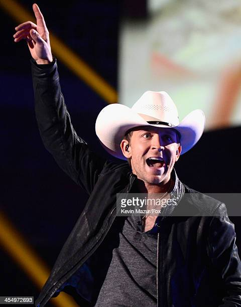 Singer Justin Moore performs onstage during the American Country Awards 2013 at the Mandalay Bay Events Center on December 10 2013 in Las Vegas Nevada
