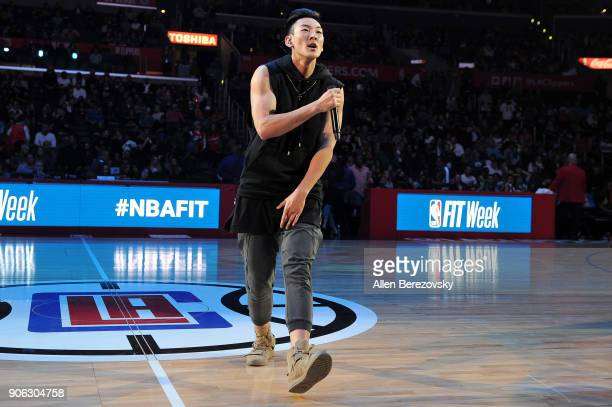 Singer Justin Park performs at halftime of a basketball game between the Los Angeles Clippers and the Denver Nuggets at Staples Center on January 17...