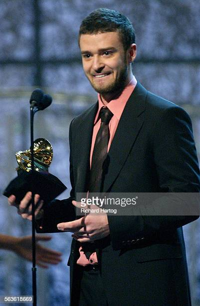 AWARDS –– Singer Justin Timberlake accepts his Grammy Award for Best Male Pop Performance during the 46th Annual Grammy Awards show at the Staples...