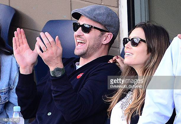 Singer Justin Timberlake and his wife Jessica Biel watch Serbian tennis player Novak Djokovic play a point against Spain's Rafael Nadal during the...