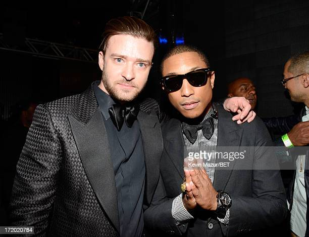 Singer Justin Timberlake and Pharrell Williams pose backstage during the 2013 BET Awards at Nokia Theatre LA Live on June 30 2013 in Los Angeles...